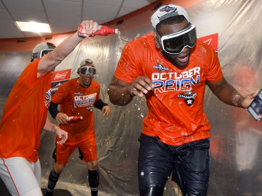 Houston Astros' Yordan Alvarez, right, celebrates the team's clinching of the AL West crown after a baseball game against the Los Angeles Angels, Sunday, Sept. 22, 2019, in Houston. (AP Photo/Eric Christian Smith)