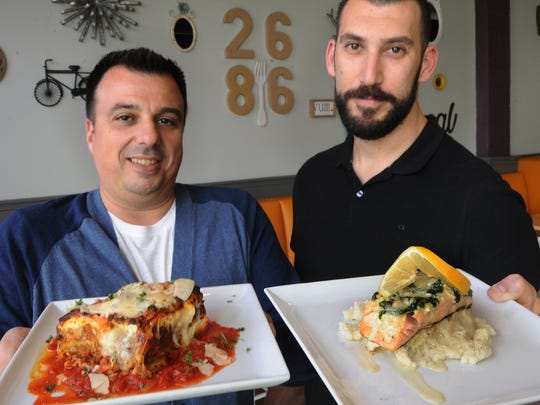 As co-owners of The 2686 Kitchen in Ventura, Joby Yobe, left, and Jorge Alem pose with dishes from the menu in a Star file photo. The restaurant is temporarily closed for the duration of the COVID-19 crisis.