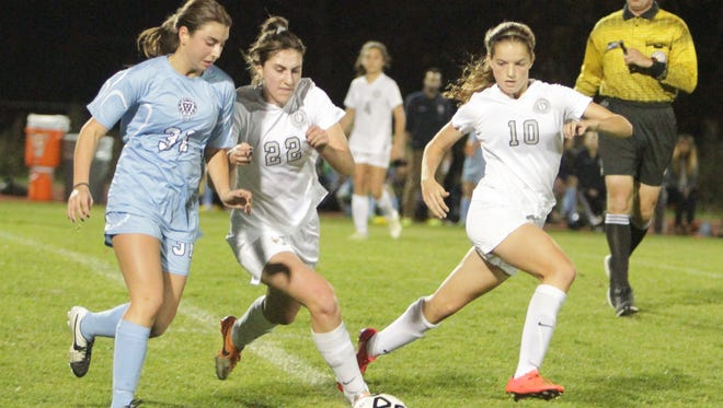 Columbia Prep's Amanda Bard (31) and Hackley's Gabriella Zak fight for possession of the ball, with Hackley's Francesca Docters looking on, during a NYSAIS quarterfinal match at the Hackley School on Wednesday, November 4th, 2015. Hackley won 2-0.