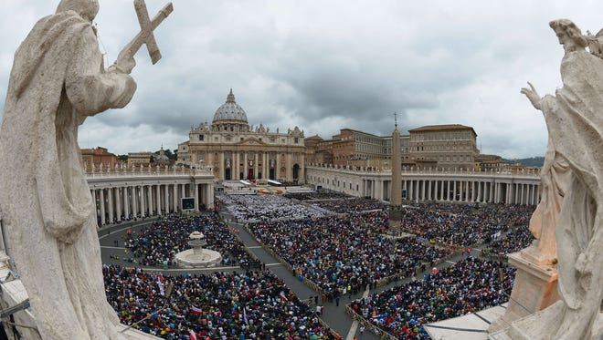 General view of the crowd gathered for the canonization mass of Popes John XXIII and John Paul II on St Peter's square at the Vatican on April 27, 2014.