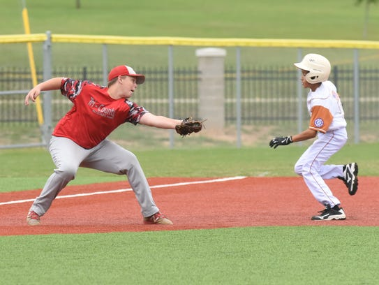 Tri-County's Garrett Statler attempts to tag an Eagle