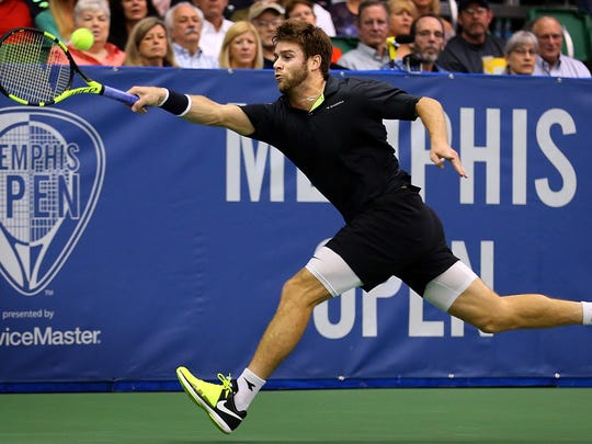 Ryan Harrison returns a volley against Nikoloz Basilashvili in the singles championship at the Memphis Open Sunday. Harrison went on to win in straight sets against Basilashvili totake home his first ATP championship.
