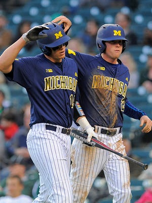 Kendall Patrick, left, Jacob Cronenworth and the Wolverines concluded their regular season with a 6-2 win over Oklahoma State on Saturday.