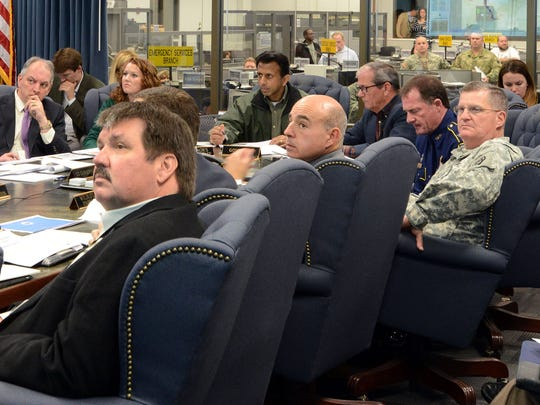 Maj. Gen. Glenn H. Curtis, adjutant general of the Louisiana National Guard, joins Gov. Bobby Jindal, Gov. Elect John Bel Edwards and other officials in a unified command group meeting to discuss plans to protect people and property from expected river flooding at the Governor's Office of Homeland Security and Emergency Preparedness' Emergency Operations Center in Baton Rouge, Jan. 8, 2016.