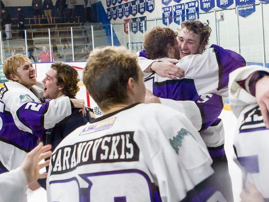 The Shreveport Mudbugs celebrate an NAHL Robertson Cup title on Monday in Blaine, Minnesota.