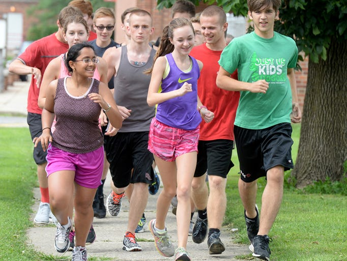 Richmond High School cross country runners practice Friday, Aug. 14 ...