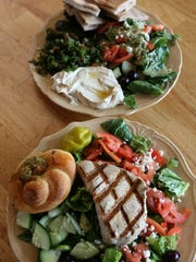 The Mediterranean sampler (top) of tabouleh, hummus,