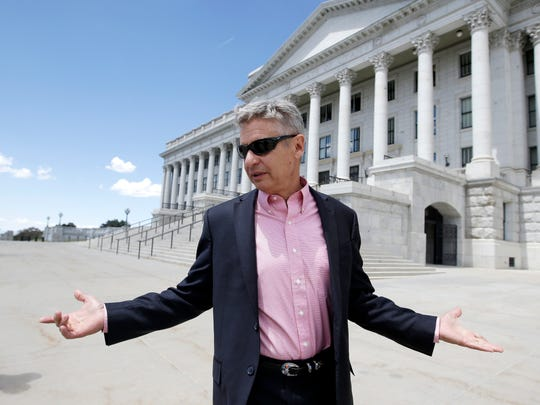 Libertarian candidate and former New Mexico Gov. Gary Johnson leaves the Utah State Capitol after meeting with with legislators Wednesday, May 18, 2016, in Salt Lake City. Seizing new fuel for his appeal to Donald Trump's critics, Johnson has joined forces with another former Republican governor to strengthen his Libertarian presidential bid. William Weld, who served two terms as the Republican governor of Massachusetts in the 1990s, will announce plans Thursday to seek the Libertarian Party's vice presidential nomination, Johnson confirmed in a Wednesday interview with the Associated Press.
