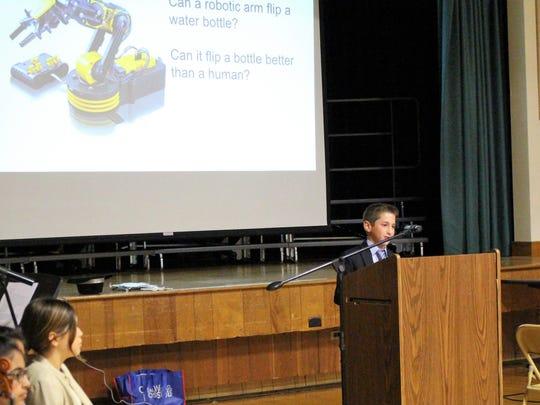 """Jordan Bash demonstrates his """"Genius Hour"""" robotic"""