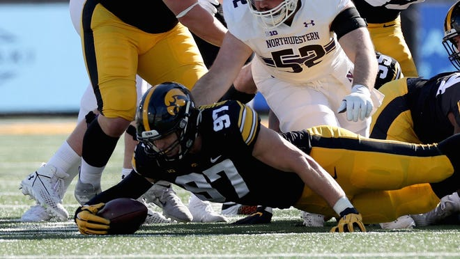 Iowa Hawkeyes defensive lineman Zach VanValkenburg (97) recovers a fumble against the Northwestern Wildcats Saturday, October 31, 2020 at Kinnick Stadium.