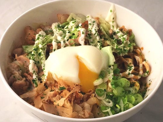 A poached egg, slices of pork belly and Parmesan cheese are included in an order of yaki maze soba, one of the ramen dishes available when the pop-up restaurant Naked Ramen opens Jan. 17 in Agoura Hills.