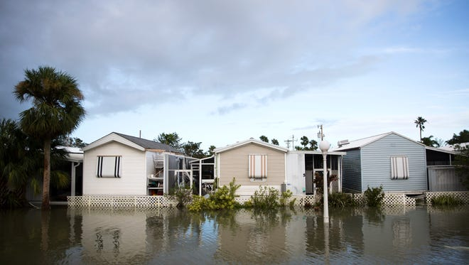 Floodwaters surround homes Monday, Sept. 11, 2017, in Everglades City after Hurricane Irma.