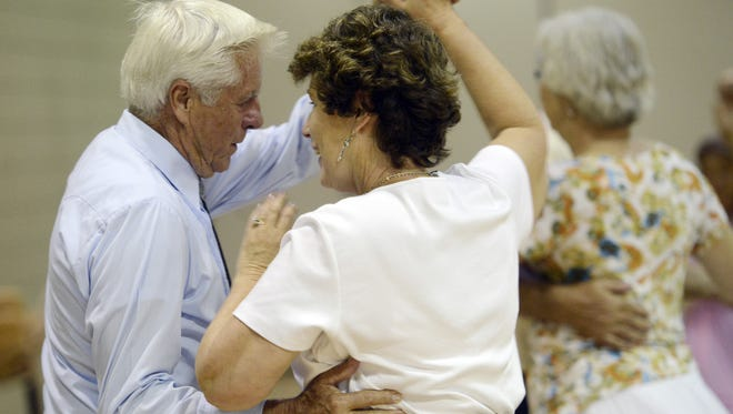 Ted Campbell dances with Linda Carr recently at a Shirts and Skirts Square Dance Club dance at Active Generations.