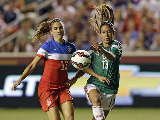 Mexico defender Bianca Sierra, (right), shown here