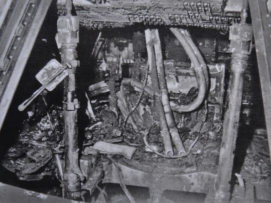 A NASA photo of the inside of the burned Apollo 1 capsule.