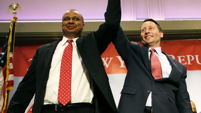 Christopher Moss, lieutenant governor candidate, and Rob Astorino, candidate for governor, celebrate at the Republican Convention in Rye Brook last month.