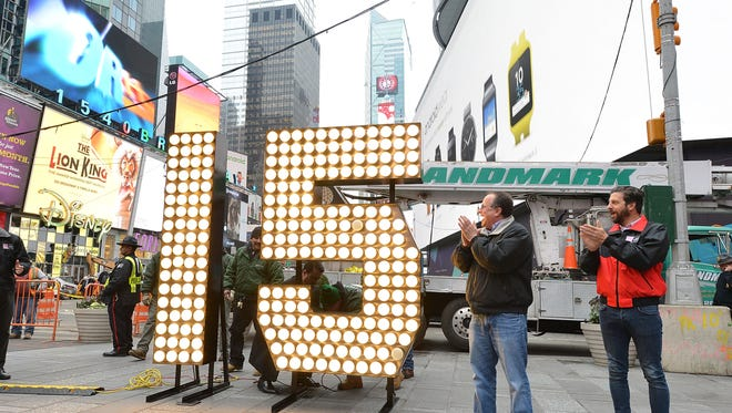 Jeffrey Straus, left, president of Countdown Entertainment, and Tim Tompkins, president of the Times Square Alliance -- co-organizers of Times Square 2015 -- watch New Year's Eve numerals arrive at Times Square prior to installation atop One Times Square on Dec. 16, 2014, in New York City.