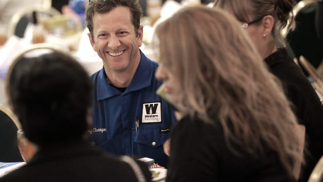 Western Refining Director of Engineering and Maintenance Troy Champeaux laughs with colleagues Wednesday during the United Way's 2016 Appreciation Luncheon at the El Paso Marriott. Western Refining was honored with the United Way's Live United-Give Award after raising $481,648 for the organization. Employees at Western Refining can opt for paycheck deductions that are donated to United Way.
