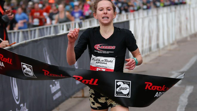 Bailey Drewes, from Ithica, NY, wins the women's marathon in the 14th Rock 'n' Roll Arizona Marathon July 15, 2017.