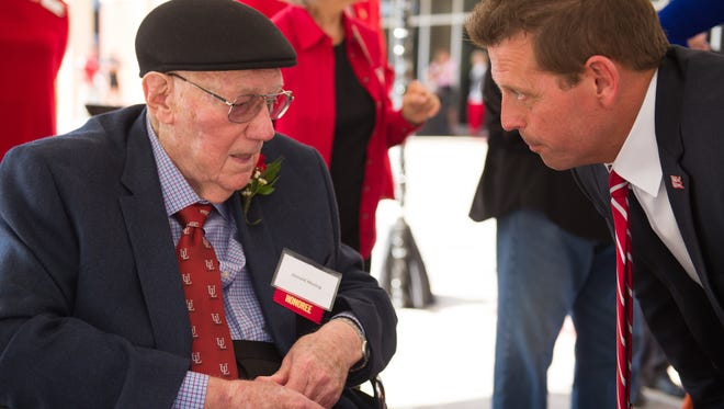 Donald Mosing speaking with UL Athletic Director Bryan Maggard, Ph.D., at the dedication and sign unveiling of the University of Louisiana Student Athlete Performance Center named for Donald and Janice Mosing in 2017. Mosing died April 31 at the age of 90.