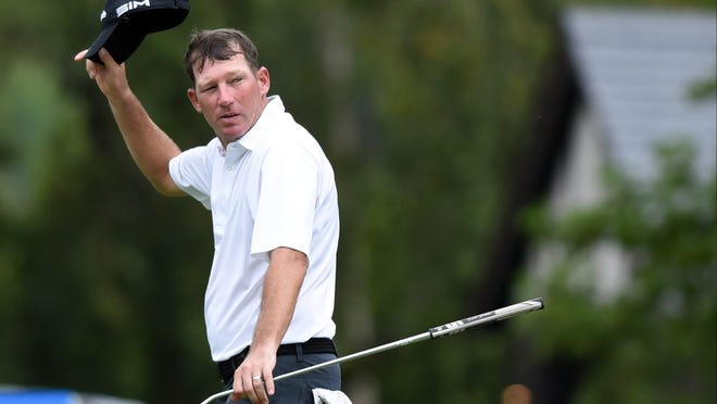 Jim Herman gestures as he leaves the 18th green during the third round of the Wyndham Championship at Sedgefield Country Club. Photo: Rob Kinnan-USA TODAY Sports