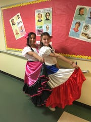 Somerville Middle School celebrates Multicultural Day. Sarah Parada and Samantha  Slater are dressed in their Costa Rican dresses.