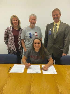 Darby Fitzpatrick, a senior softball player at Holly Grove, signs her letter of intent to play at Division II Concord University.