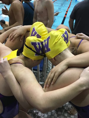 The Waynesboro High School swim team huddles before the start of the Ben Hair Memorial Swim and Dive meet. Waynesboro's swim and dive team is the only one in the district.