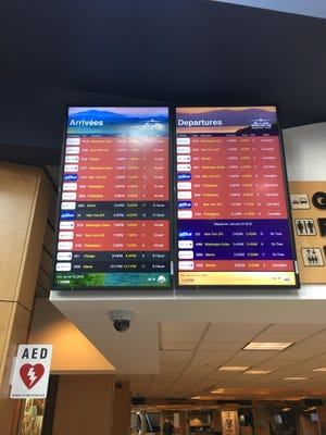 Arrival and departure board at Burlington International Airport on Saturday shows all the flight cancellations in red.