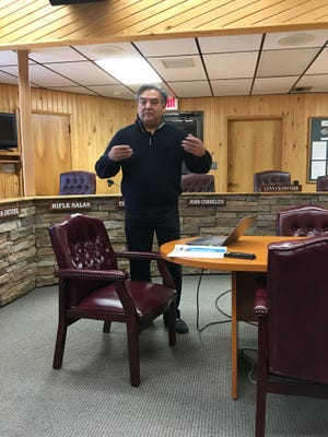 Godfrey Enjady, head of Mescalero Apache Telecom, Inc., discusses the region's Internet connectivity issues at a briefing at Village Hall Monday.