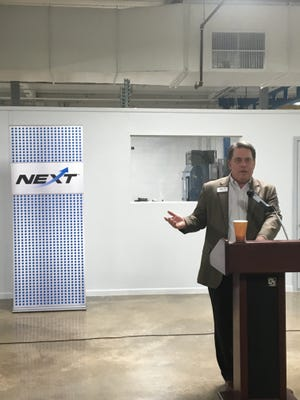 NEXT CEO John Moore addresses the crowd at the NEXT Manufacturing Center's grand opening.