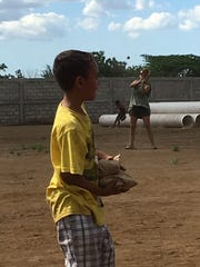 Before departing Nicaragua on a seven-day mission trip, the St. Joseph Catholic School crew plays baseball with village children.