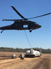 A Louisiana National Guard helicopter picks up a 1,500-pound