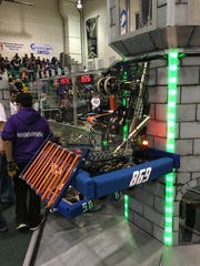 The Middlesex High School Robot scales an opponent's tower.