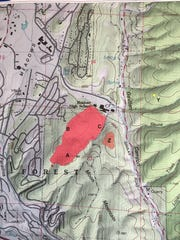 The red zone is the main burn area. The smaller brown area to the right was a greater concern Wednesday. A tiny yellow area at far right is a hot spot that appeared Monday across Gavilan Canyon Road and was quickly suppressed.