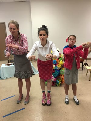 """Writer-director Alexandra Dipp, center, rehearses with cast members from """"Garden of Fluorescent Flowers,"""" debuting Sunday in the Philanthropy Theatre in the Plaza Theatre in Downtown El Paso."""