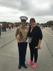Proud mother Sally Freed with Marine Pfc. Amy Freed at Amy's graduation ceremony Friday at Parris Island, S.C.