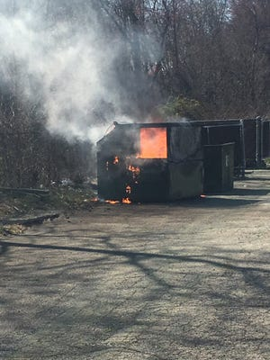 Fire fighters battled this Dumpster fire in the parking lot of the Zeris Inn in Mountain Lakes on Sunday afternoon, April 17.