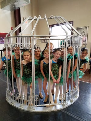 Dali dancers test the fit of their birdcage for one of the numbers in this weekend's Cirque Dali.