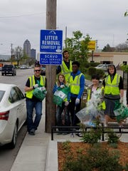 """Scavo student volunteers conducted a """"Trash Bash"""" neighborhood cleanup April 22 as an Earth Day observance. Scavo """"adopted"""" its neighborhood in partnership with the City of Des Moines in an ongoing effort to limit litter in the area."""