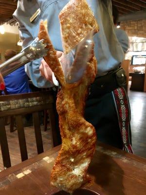 Pork belly, cut tableside from Rodizio Grill in Estero.