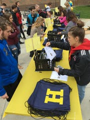 Last year, Hartland High School seniors line up during