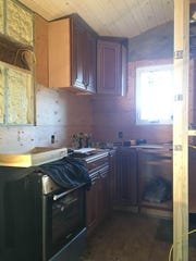 The kitchen of Joshua Slovensky's and Crescentia Danner's tiny home is equipped with a 2- by 2-foot propane stove and an 11-cubic-foot refrigerator. Eventually, they'll add a washer/dryer combination.