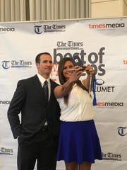 Drew Brees takes a selfie with Calvary softball coach Tiffany Frazier on Mondayat the The Times Best of Preps banquet.