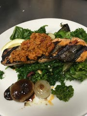 Grilled Wild Salmon on braising greens and cippolini, with romesco at Paradiso at The Grand Theatre.