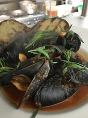 Mussels with tomatoes and tarragon at Paradiso at The Grand Theatre.