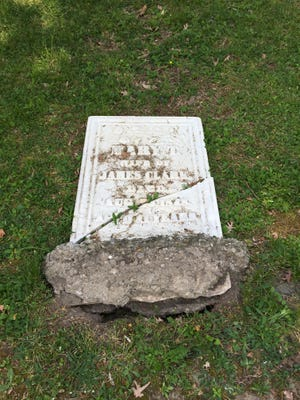 A marble headstone, cleaned and restored by the Friends of the Ithaca Cemetery recently, was found uprooted and cracked earlier this week.