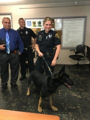 Officer Jamie Buffone and her partner, Rex, pose for pictures after the K-9 was sworn in June 2016.