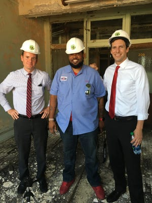 (Left to right) Kevin Wright, Allen Woods and PG Sittenfeld stand inside the Durner Building in Walnut Hills on June 20, 2016.
