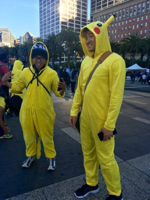 Two Pokemon Go players dressed in Pikachu pajamas for San Francisco's first Pokemon Go Crawl.